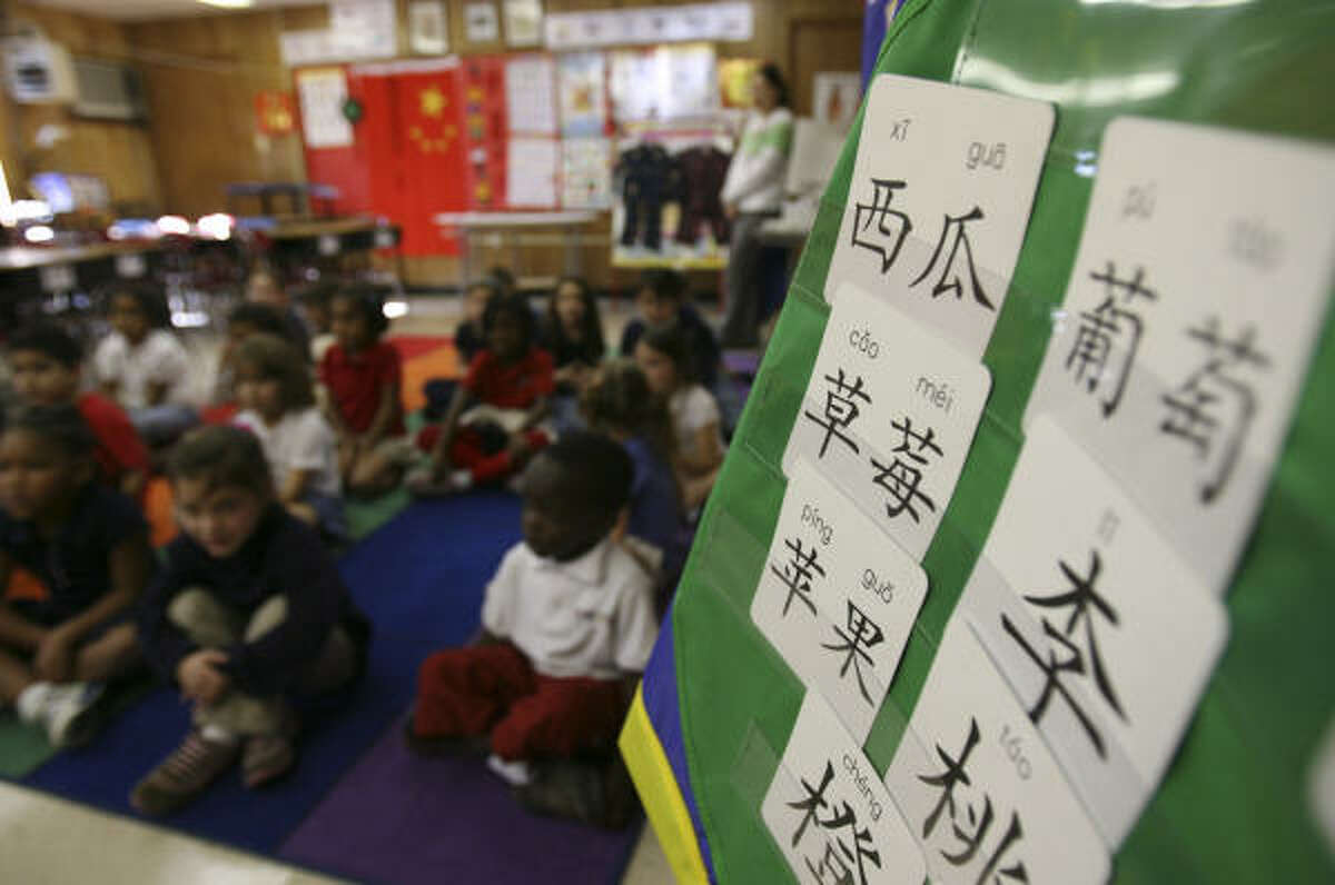 Kindergartners at Kolter Elementary in southwest Houston sing a song in Mandarin Chinese during class recently.