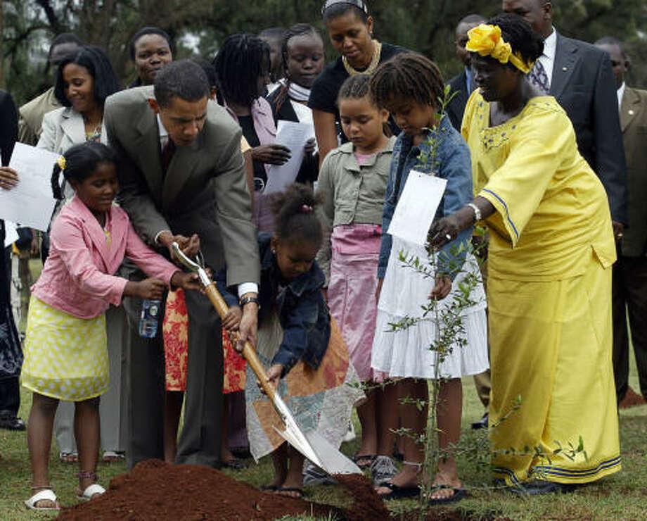 Senator Obama, with 2005 Nobel Prize Wangari Mathai, in yellow, plants a tree during a ceremony in Nairobi, Kenya. Photo: SIMON MAINA, AFP/Getty Images