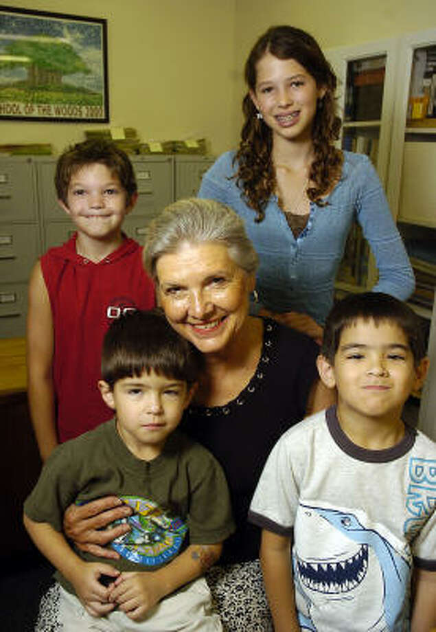 Retiring admissions director Lucy Metzler at the School of the Woods Thursday Aug. 24,2006. With Metzler are(clockwise from top)Lauryn Welling, age 11, Daniel Romero, age 6, Joseph Romero, age 3 and Dylan Welling, age 8. (Dave Rossman/For the Chronicle) Photo: Dave Rossman, For The Chronicle