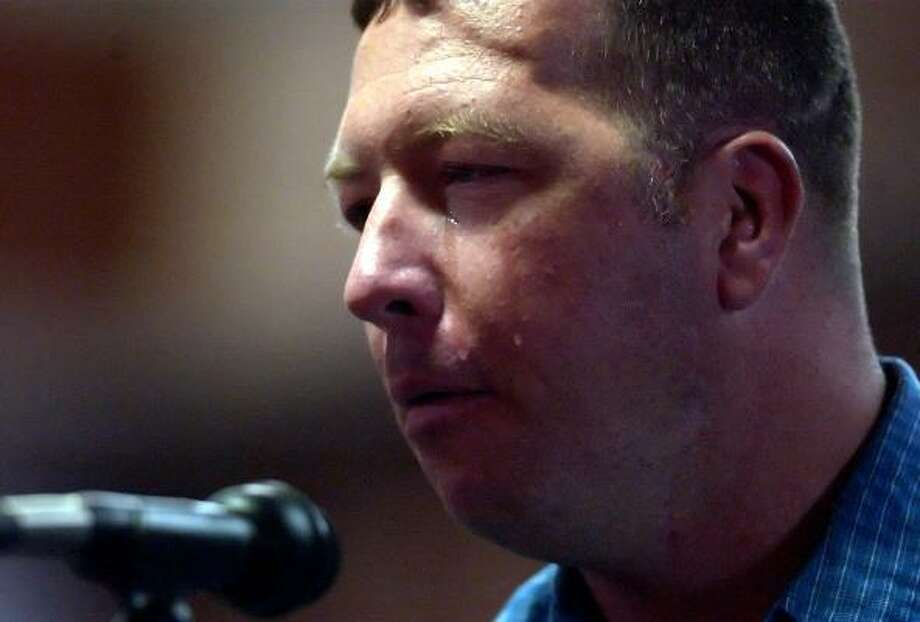 Sgt. 1st Class Charles Hunt, of 4th Brigade, 4th Infantry Division, tells a Defense Department hearing in Killeen how his deployment to Iraq affected his mental stability after he witnessed the death of fellow soldiers when his vehicle was destroyed in an explosion. Photo: STEVE TRAYNOR, The Killeen Daily Herald