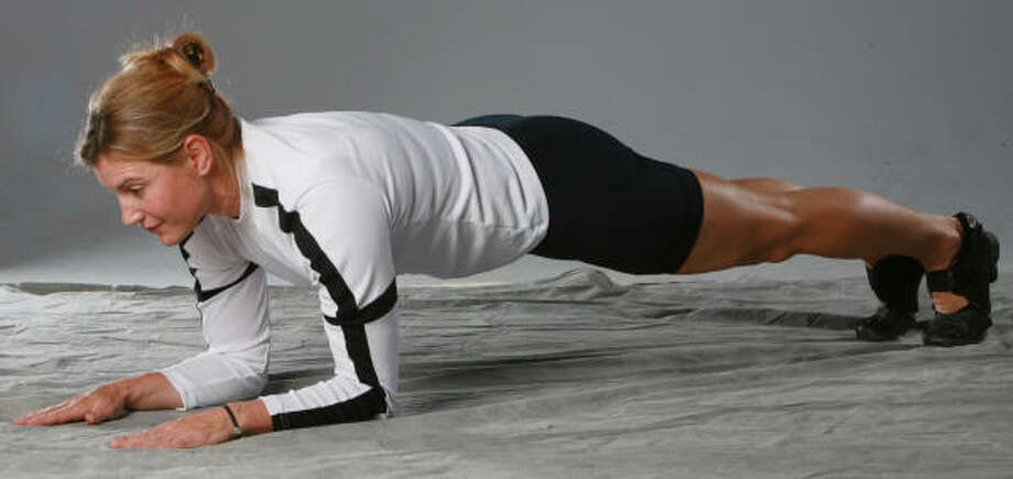 STEP 1: Kathy Kaehler demonstrates the traditional plank position, which strengthens core muscles. Photo: Los Angeles Daily News