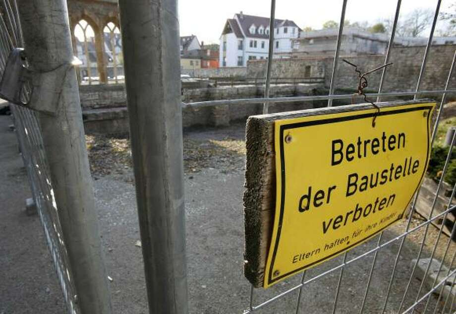 A fence surrounds the location at the monastery in Erfurt, Germany, where the Rev. Roland Weisselberg set himself ablaze Nov. 8. Photo: JENS MEYER, AP