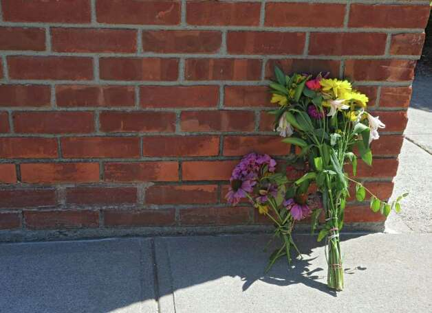 Flowers rest against a brick wall outside of St. Matthew's Church in Voorheesville, N.Y. on Thursday, Aug. 11, 2011 where three women were killed. (Lori Van Buren / Times Union archive) Photo: Lori Van Buren