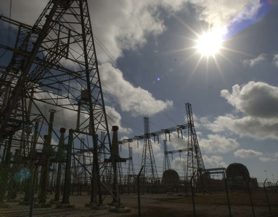 Monthly bills for Houston natural gas and power customers are expected to drop soon. Photo: Steve Ueckert, Chronicle
