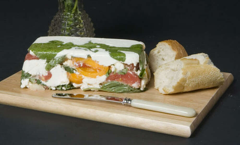 Red and yellow tomatoes, arugula and goat cheese make up this colorful terrine. Photo: Steve Campbell, Chronicle