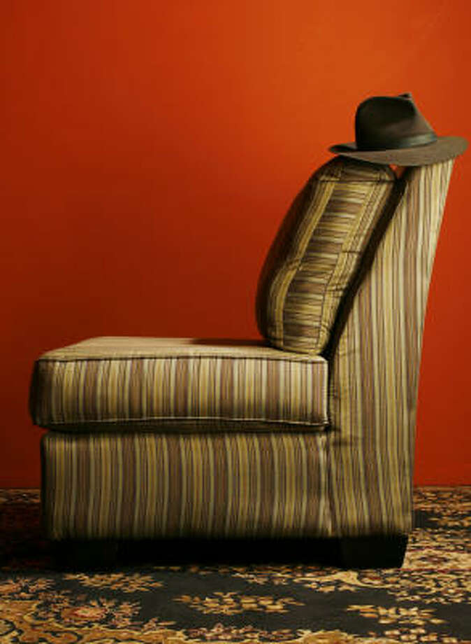 The striped upholstery of a Durabella chair from Finger Furniture could easily be paired with a microfiber or leather sofa. Photo: Nick De La Torre, CHRONICLE