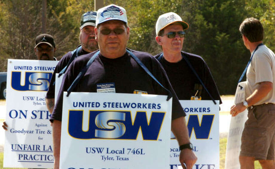 Goodyear Tire & Rubber Co. plant workers picket outside the plant in Tyler on Thursday. Photo: TOM WORNER, AP