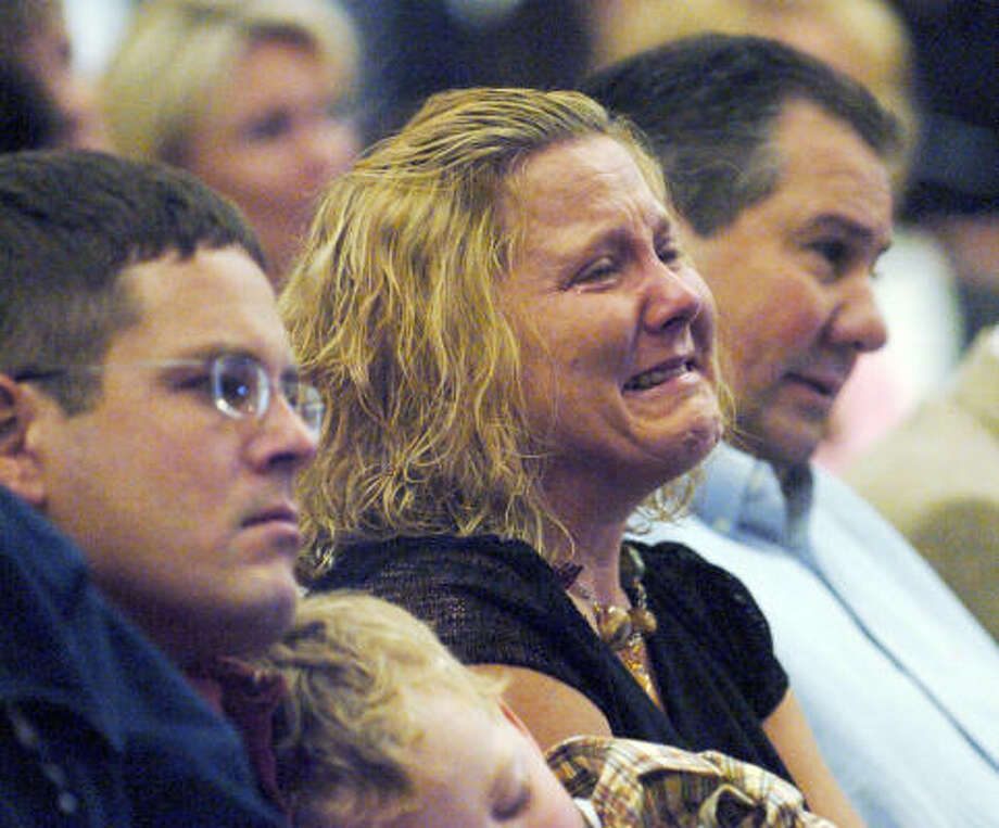 A woman weeps during services at the New Life Church in Colorado Springs, Colo., on Sunday where a letter was read in which the founder and pastor Rev. Ted Haggard confessed to his followers that he was guilty of sexual immorality. The Overseer Board of the church fired Haggard on Saturday. Photo: HELEN D RICHARDSON, AP