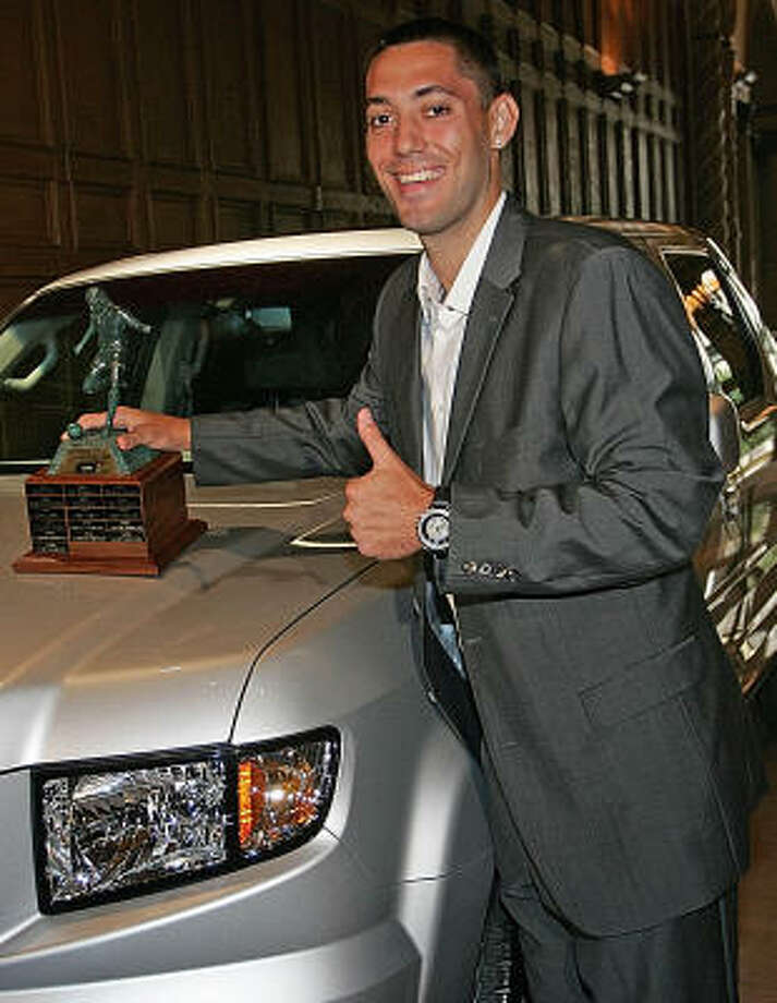Clint Dempsey gave a Honda pickup truck, which comes with the U.S. Player of the Year award, to his father, Aubrey. Photo: BRANIMIR KVARTUC, AP