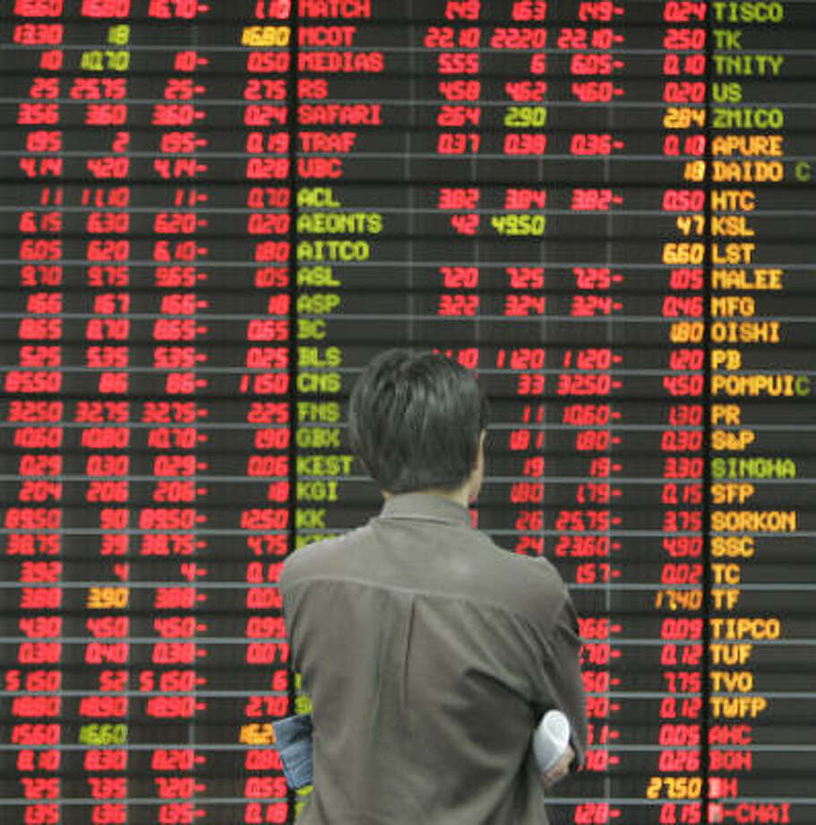 An investor monitors an electronic board on a private trading floor in Bangkok on Tuesday. Photo: APICHART WEERAWONG, AP