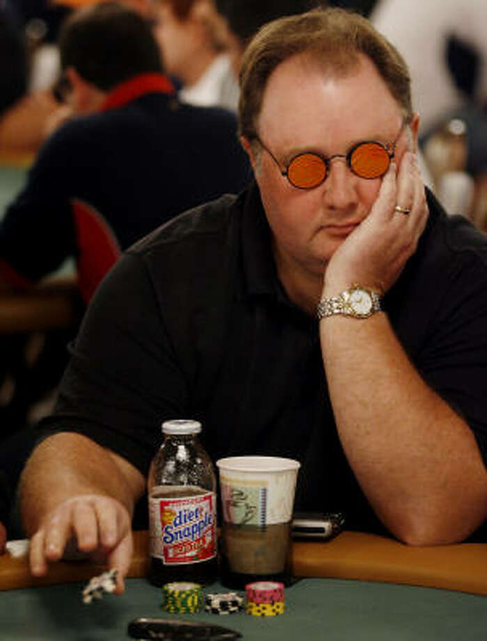 Greg Raymer raises a pot during the World Series of Poker at the Rio All-Suite Hotel & Casino in Las Vegas on Sunday. Photo: ISAAC BREKKEN, AP