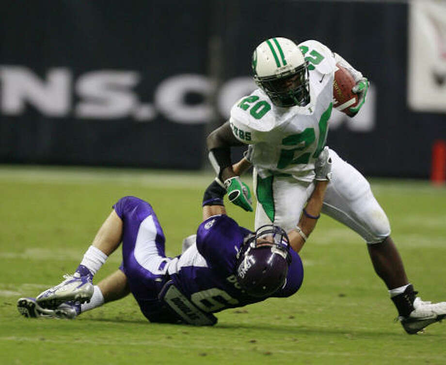 Brenham's Ryan Roberson (right) is brought down by Port Neches-Groves' Brett Doty during the first quarter at Reliant Stadium. Photo: James Nielsen, Chronicle