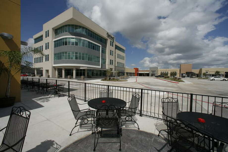 Developer Option 1 Realty Group will occupy the top story of the office part of Park Plaza in the Katy area as its headquarters. Photo: Steve Campbell, Chronicle