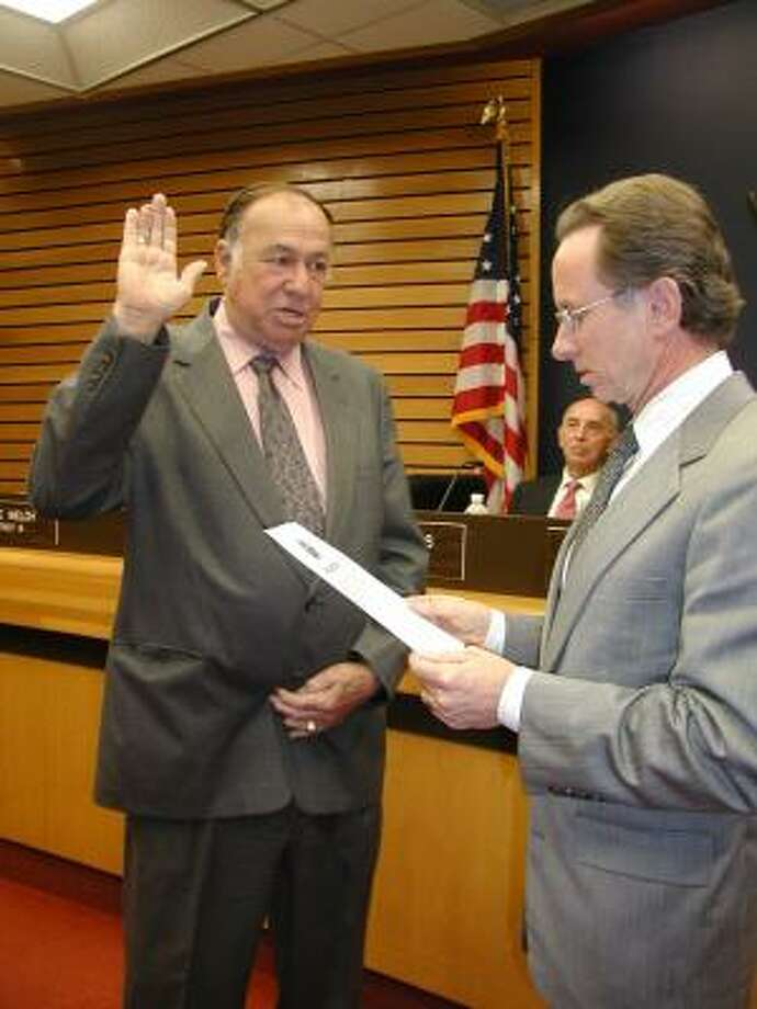 Leroy Stanley, left, was sworn in as a Pasadena councilman Tuesday night by Mayor John Manlove after a 14-month court battle. Photo: Fannie Williams, For The Chronicle