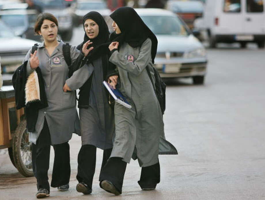 Students in southern Beirut, Lebanon, are typical of the diverse views on appropriate dress among Muslim and Christian women. Photo: NASSER NASSER, AP