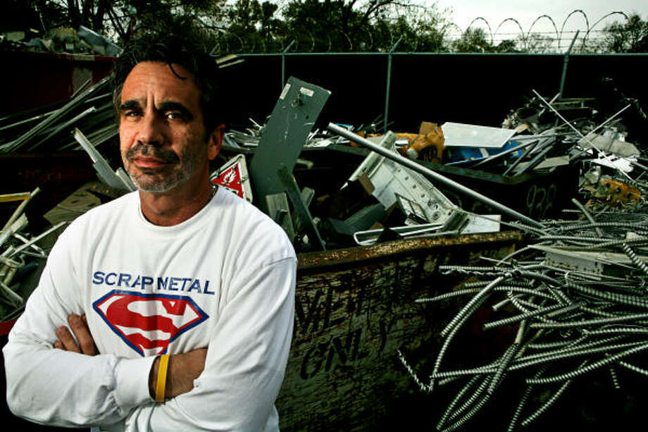 Dennis Laviage, owner of C&D Scrap Metal Recyclers, has spent $180,000 to install barb wire, security cameras and security lighting to protect his yard against thieves. Photo: ERIN TRIEB, FOR THE CHRONICLE