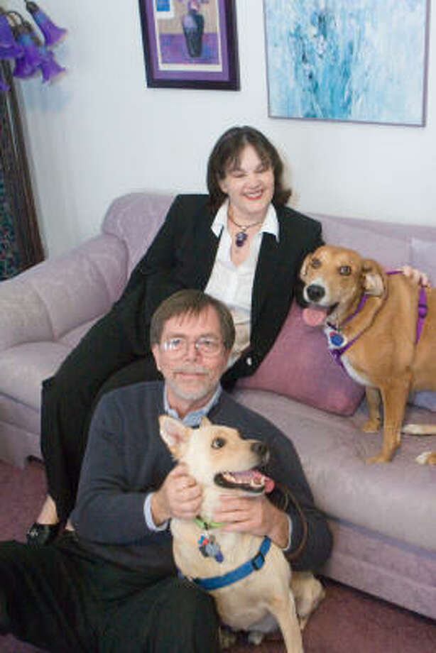 John Kane and Elizabeth Asher, with their dogs Buddy in front, and Zelda, are founders of Rescue Bank. Photo: R, Clayton McKee, For The Chronicle