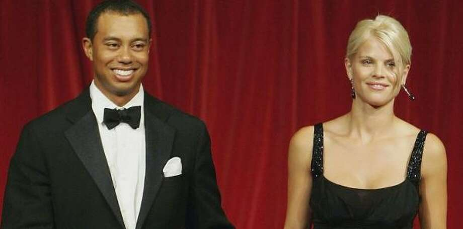 Tiger Woods is upset about a false magazine report that his wife, Elin, appeared in nude photographs. Photo: David Cannon, Getty Images