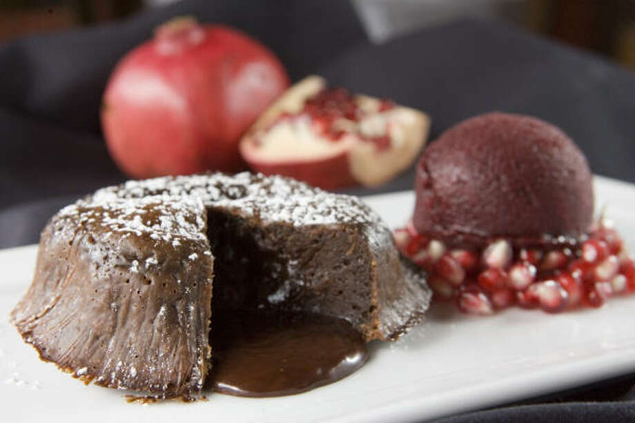 Mockingbird Bistro's granita, made from pomegranate juice, is served alongside a warm chocolate torte. Photo: BRETT COOMER, CHRONICLE