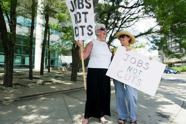 Mabel Dudeney, left, and Kate Tepper rally in front of the Government Center and office of Congressman Jim Himes in Stamford, Conn., August 10, 2011. The effort, organized by a group called the American Dream Movement, was aimed at urging Himes to focus on jobs rather than cuts to nationally funded programs. Photo: Keelin Daly / Stamford Advocate