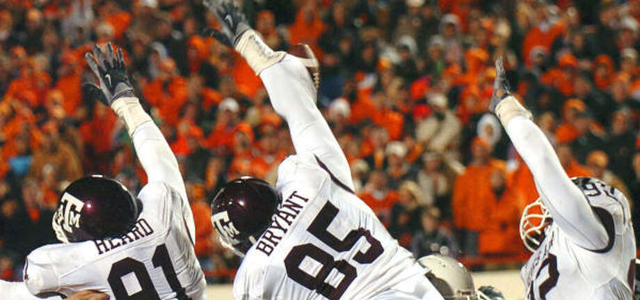 Red Bryant's deflection of Oklahoma State's extra point attempt in overtime sealed the win for the Aggies. Photo: MICHAEL DOWNES, AP