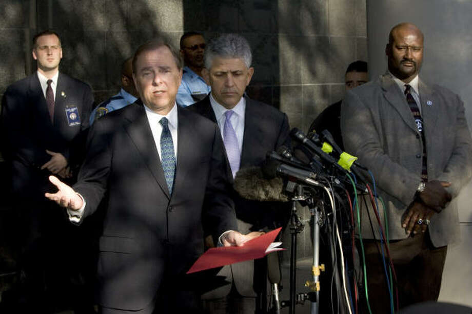 Former Enron CEO Jeff Skilling answers questions as he stands with his attorney Daniel Petrocelli after being sentenced on fraud and conspiracy charges on Monday. Skilling was sentenced to to 24 years and four months in prison for his role in the energy company's 2001 collapse. Photo: BRETT COOMER, CHRONICLE