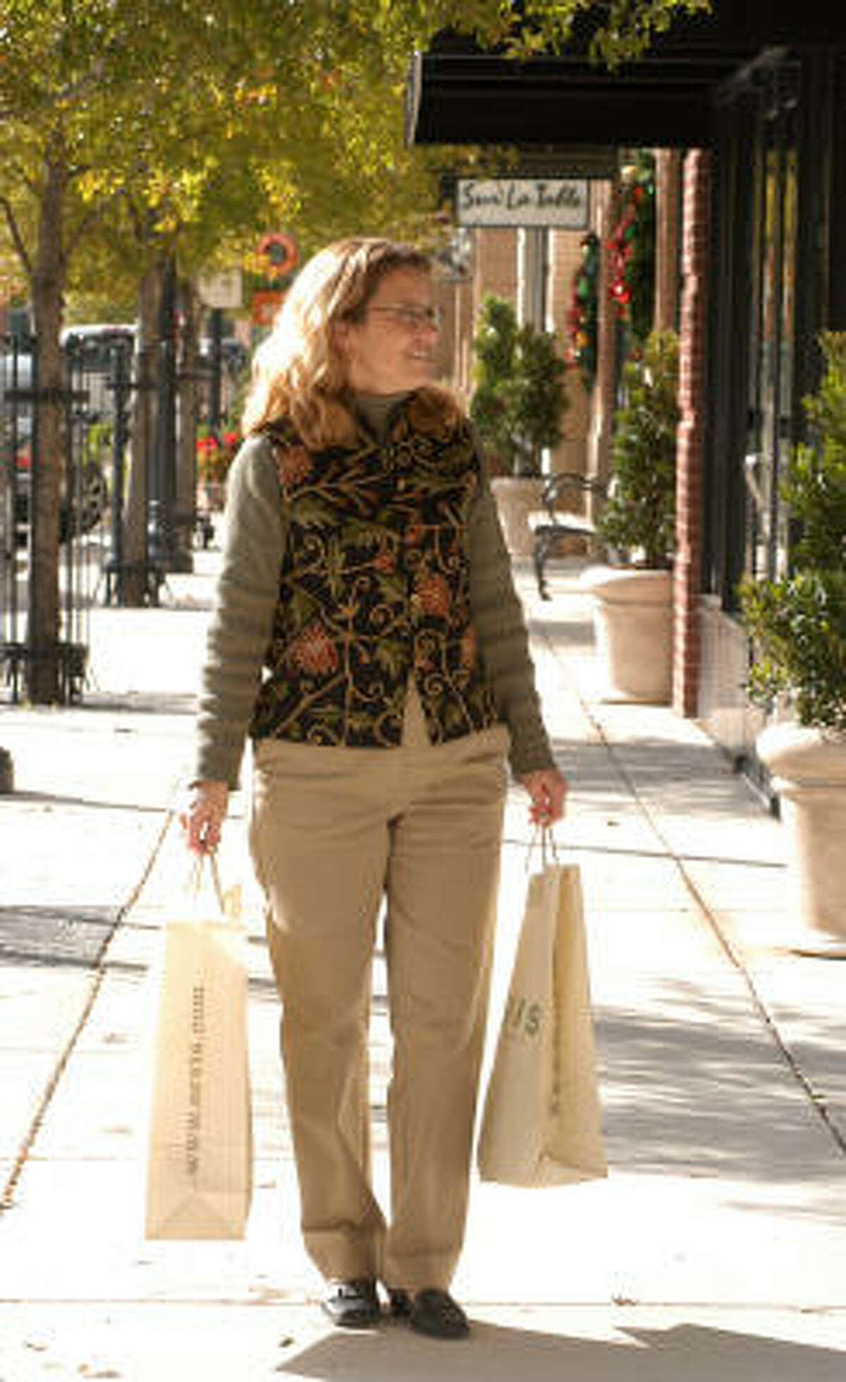 Glenda Cammarata of The Woodlands carrys her shopping bags during a trip to Market Street. The retail and entertaimnent center in The Woodlands is gearing up for the holiday season.