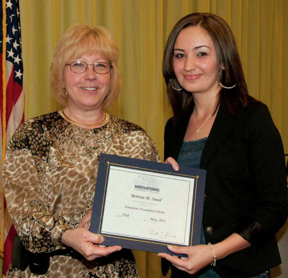 Paula Chapla, a member of the board of directors of the Housatonic Community College Foundation Inc., left, gives the Housatonic Foundation Scholar award to Housatonic Community School graduate Berivan Saeed. Photo: Contributed Photo / Roger Salls Photography  2011