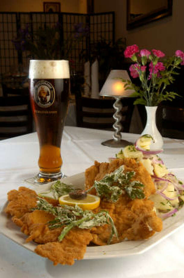 Wiener schnitzel with Austrian potato salad and Spaten Oktoberfest Beer at Charivari, a Transylvania restaurant found on 2521 Bagby St. Photo: BRETT COOMER, CHRONICLE