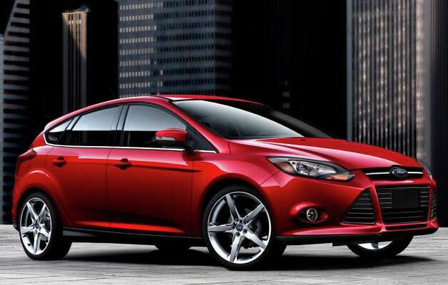 The cool looks of the 2012 Ford Focus hatchback come from its European styling. It's No. 3 on Kelley's back-to-school list of new cars. COURTESY OF FORD MOTOR CO. Photo: Ford Motor Co., COURTESY OF FORD MOTOR CO. / Ford