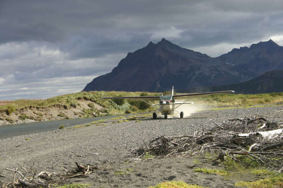 A bush plane fitted with tundra tires opens the banks of remote salmon streams to anglers in Alaska. Photo: Joe Doggett, Houston Chronicle