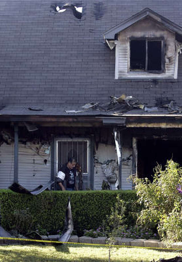 Many candles were found at the home of former state Sen. Frank Madla after an early-morning fire. Photo: WILLIAM LUTHER, San Antonio Express-News