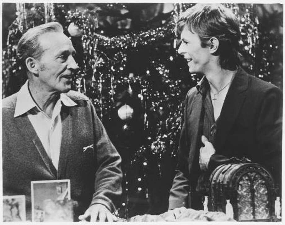 Amercian pop singer Bing Crosby, left, and British rock singer and actor David Bowie perform for the 1977 TV special, Bing Cosby's Merrie Olde Christmas, which featured the song Peace on Earth / Little Drummer Boy. Photo: CBS