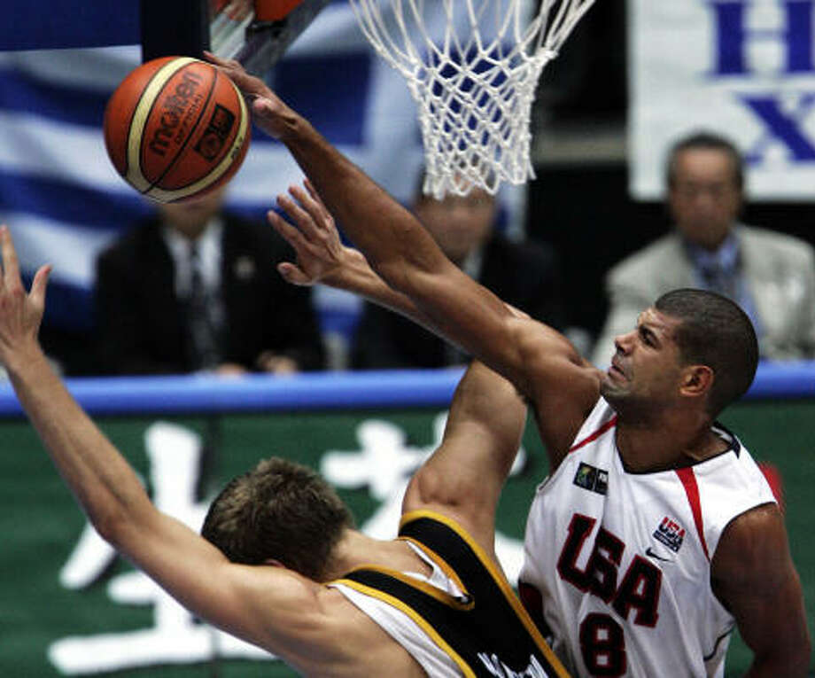 Shane Battier, right, swats away Dirk Nowitzki's shot during Wednesday's U.S victory over Germany. Photo: DAVID LONGSTREATH, AP