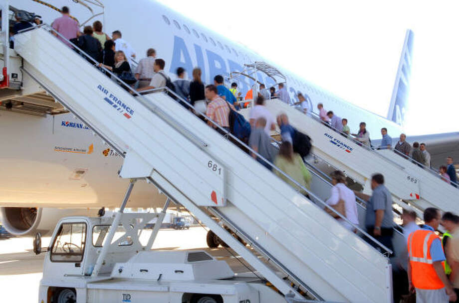 Some of the 474 employees on the Airbus A380's first passenger flight ascend to the aircraft in Toulouse, France. Photo: ASSOCIATED PRESS