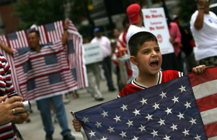 Rodrigo Ortiz, 7, marches down Walker Street in a Labor Day immigrant rights rally in downtown Houston today. Photo: Sharon Steinmann, Houston Chronicle