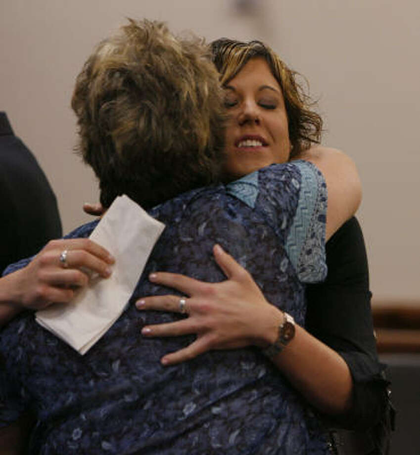 Eva Rowe, right, embraces Carol Ware, a secretary for her attorney, after reaching a settlement Thursday with BP in the deaths of her parents. Rowe, 22, has vowed to use some of the money to crusade for workplace safety nationwide. Photo: Steve Campbell, Chronicle