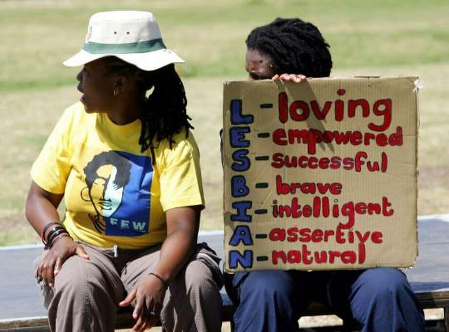 A lesbian couple rest during their march in Soweto, South Africa, in September. Gays in Soweto often live their lives in fear of violence. Photo: SIPHIWE SIBEKO, REUTERS