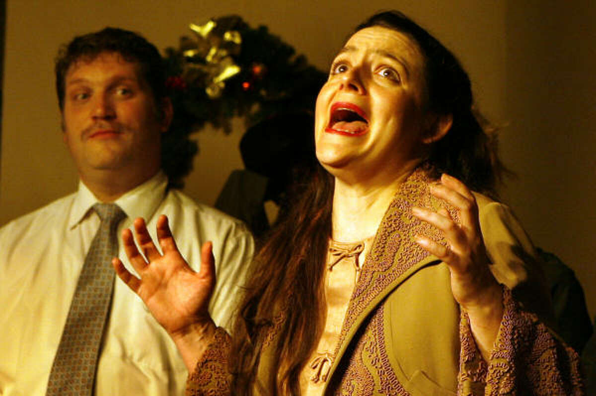 Linda Lay (Jessica Love Barnes) and Andy Fastow (David Heyen) lament the scandal in the spoof Enron — the Musical.