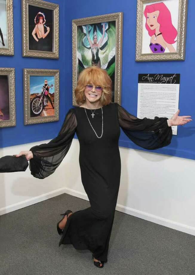 Saratoga Springs, NY - August 6, 2011 - (Photo by Joe Putrock/Special to the Times Union) - Screen and dance legend Ann-Margret strikes a pose in front of the Ann-Margret exhibit at the National Museum of Dance during the National Museum of Dance Silver Anniversary Gala. Photo: Joe Putrock / Joe Putrock
