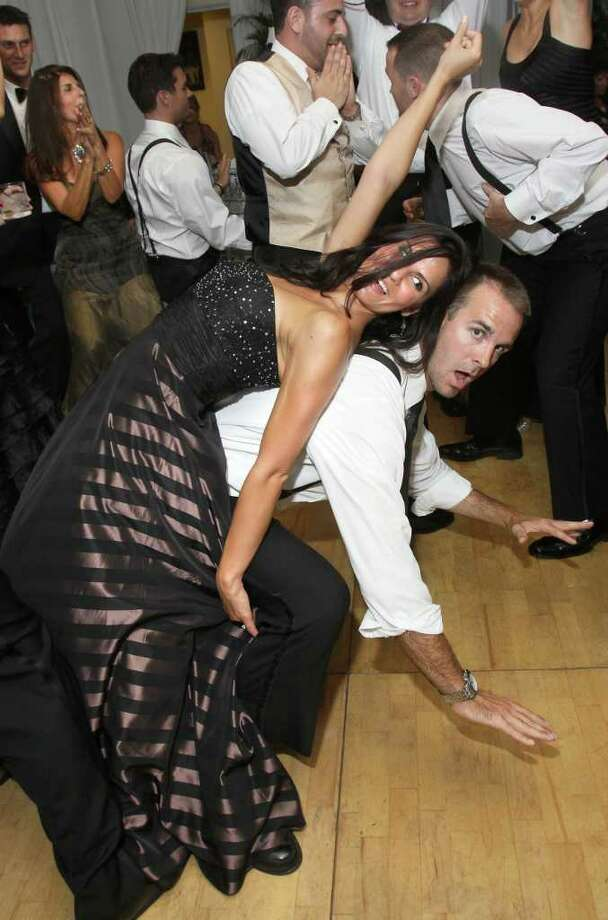 Saratoga Springs, NY - August 6, 2011 - (Photo by Joe Putrock/Special to the Times Union) - Katie Roeder(left) shows off how limber she is while dancing with Jay Jones(right) during the National Museum of Dance Silver Anniversary Gala. Photo: Joe Putrock / Joe Putrock