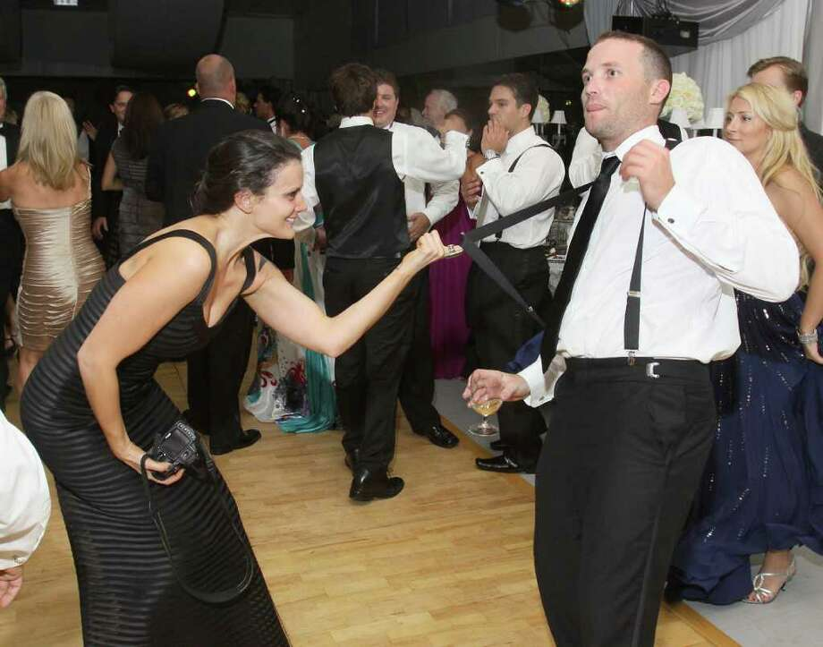 Saratoga Springs, NY - August 6, 2011 - (Photo by Joe Putrock/Special to the Times Union) - Alyssa Ciccarelli(left) uses Alex Wotring's(right) suspenders to keep him on the dancefloor during the National Museum of Dance Silver Anniversary Gala. Photo: Joe Putrock / Joe Putrock