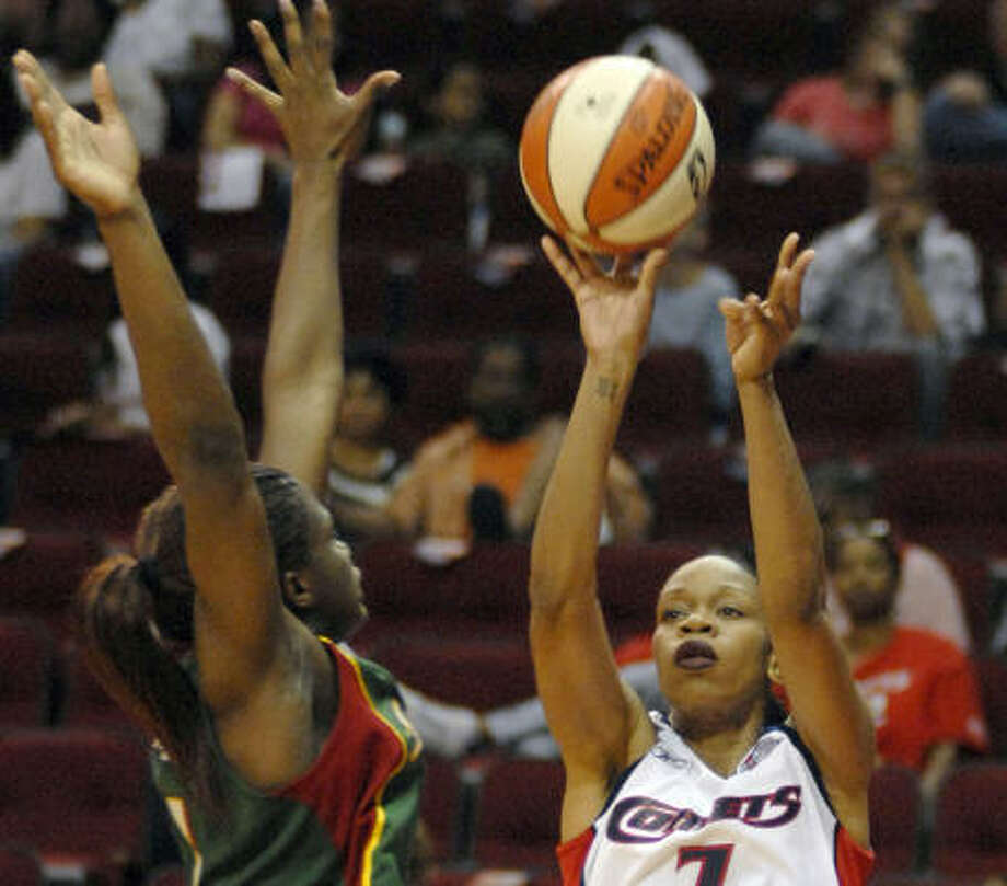 Houston's Tina Thompson over Seattle's Barbara Turner at Toyota Center. Staley is retiring after this season. Photo: TIM JOHNSON, AP