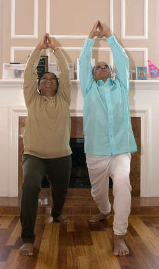 Bettadapura Shankar Rama Rao, right, and his wife, Meera, are certified yoga teachers and therapists. They reside in the Alief area's Providence subdivision. Photo: R. Clayton McKee, For The Chronicle