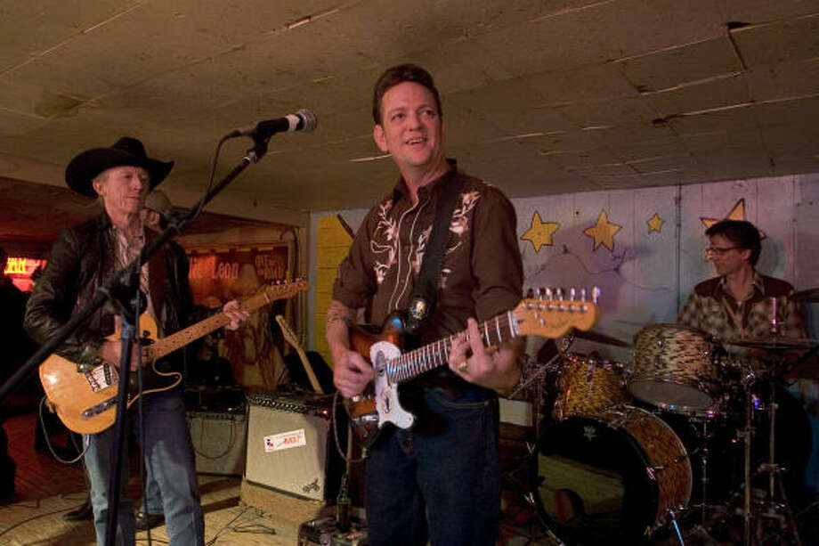 Rick Broussard performs Wednesday at the Broken Spoke in Austin with bandmates John X Reed, left, and drummer Scott French. Photo: Ted Albracht, For The Chronicle