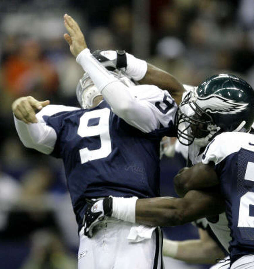 Trent Cole drew a personal foul for this hit on Tony Romo, but things mostly went Philly's way. Photo: Matt Slocum, AP