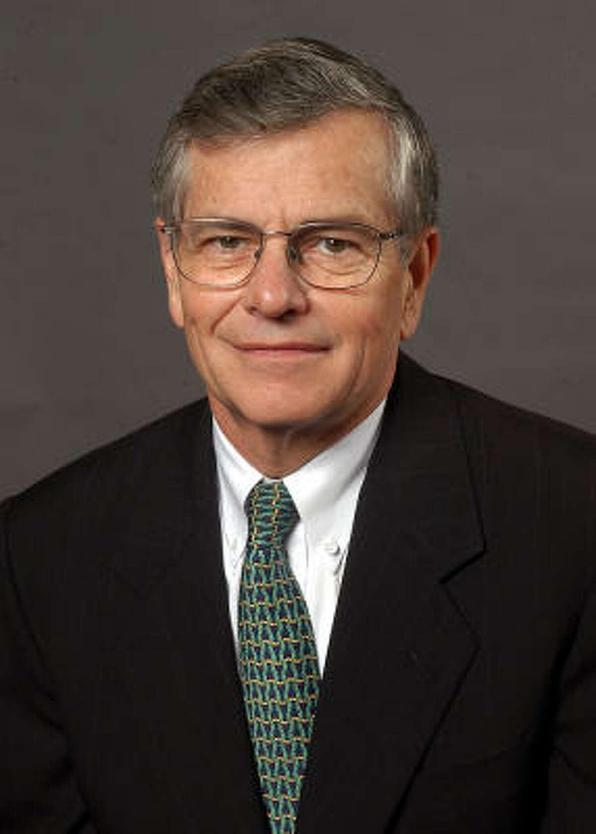 Rep. Tom Craddick, left, uses