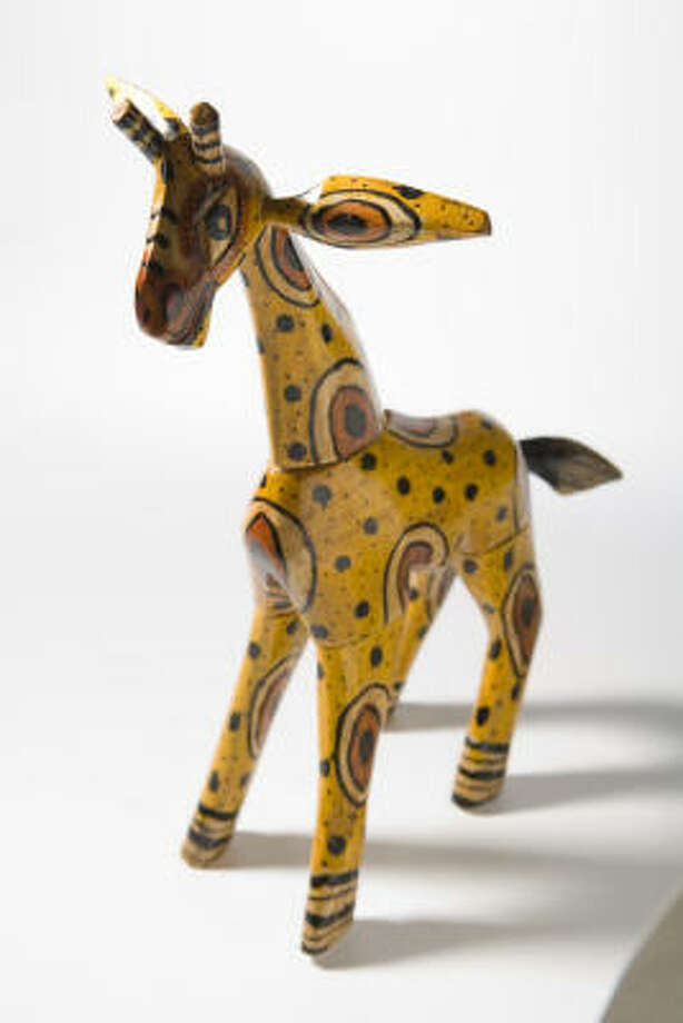 Wooden giraffe, $17.50, from Mystical Treasures. Photo: Kevin Fujii, Chronicle