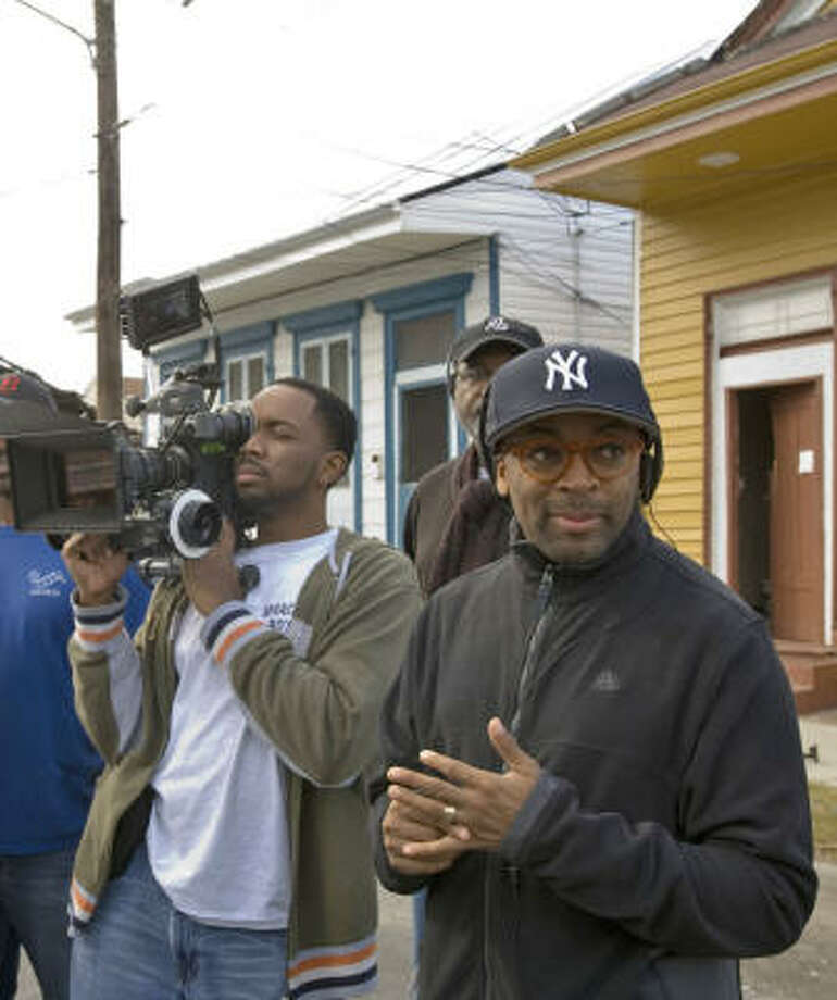 Director Spike Lee, right, revisits the shattered Lower Ninth Ward in New Orleans while filming When the Levees Broke. Photo: HBO