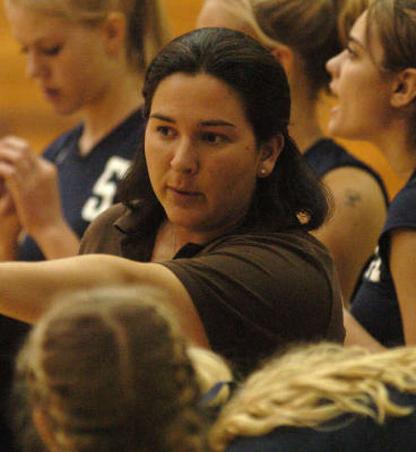 Kingwood volleyball coach Ashley Earhart makes a point to her team. Earhart played for the Mustangs 15 years ago. Photo: David Hopper, For The Chronicle